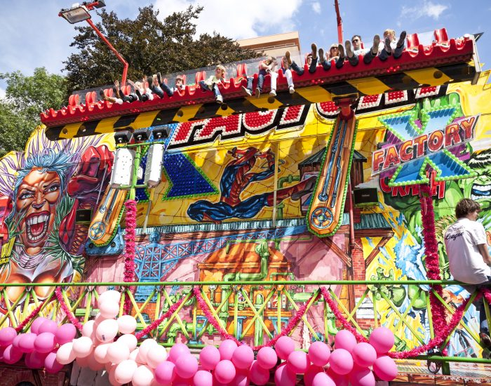 """Tilburg, the Netherlands - July 20, 2009: A spectacular ride at the fun fair of Tilburg. Tilburg is known for its annual 10-day fair, the largest in the Benelux. The Monday during the fun fair is called 'Roze Maandag' (Pink Monday)."""